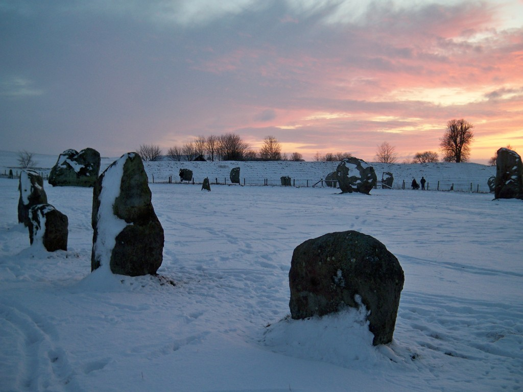The Lodge, Avebury - The henge, cloaked in snow as the sun sets over the stones.